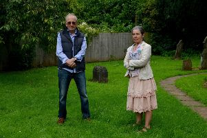 Concerns over plans to sell off part of the graveyard at Holy Trinity Church, Kimberley, pictured is Gordon Barksby and Parish Councillor Susan McEntee