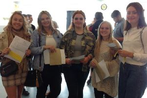 Students collect their GCSE results.