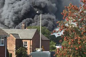 Smoke ploughing from the building in Eccleston. Picture: Jonny Banks