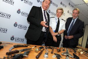 Assistant Chief Constable Kate Meynell with police and crime commissioner, Paddy Tipping (right), looking over knives handed in at a previous amnesty in the county.