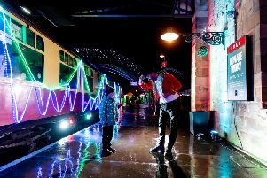 The festive train lights up Pickering Station