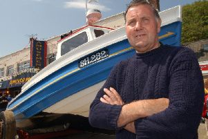 Jim in front of his coble. Picture: JPI Media