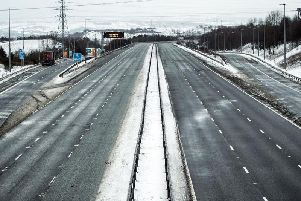 The M62 has been closed for most of the night and will remain shut today as high winds and snow cause havoc. Picture PA