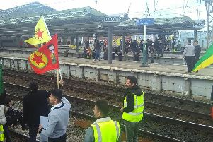 Campaigners at Manchester Piccadilly railway station. Picture: PA Wire.