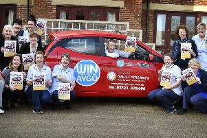 Promoting the car raffle.