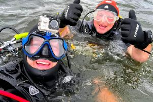Warren and Anthony diving for the phone.