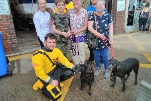 Lexi and Cleo reunited with their owners in Filey. PIC: RNLI