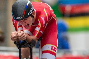 Mikkel Bjerg powers through the rain to win the men's under-23 time trial. Picture by Bruce Rollinson.