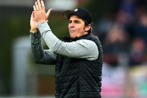 Joey Barton applauds the crowd after Fleetwood Town's defeat by Ipswich