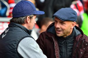 Joey Barton greets Paul Tisdale, whose MK Dons side arrived at Highbury with a defensive mindset
