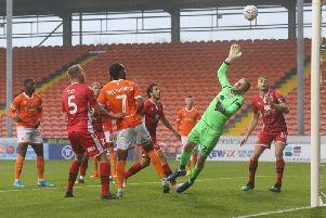 Nathan Delfouneso opens the scoring for Blackpool against Morecamber