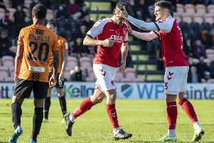 Ched Evans is congratulated by Danny Andrew (right) on opening the scoring for Fleetwood