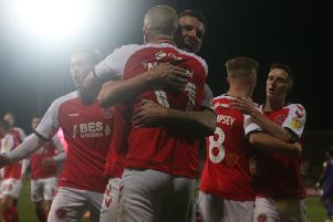 Ash Eastham celebrates Fleetwood's winner against Tranmere with scorer Paddy Madden