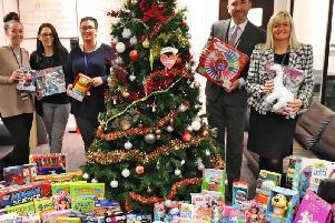 Staff at BES Utilities with some of the toys they have collected