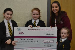 Chloe Rossall from Trinity Hospice and Brian House, with Chaucer Primary School youngsters