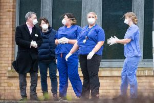Members of staff wait as coaches carrying Coronavirus evacuees arrive at Kents Hill Park Training and Conference Centre, in Milton Keynes, after being repatriated to the UK from the coronavirus-hit city of Wuhan in China yesterday (Picture:Aaron Chown/PA Wire)