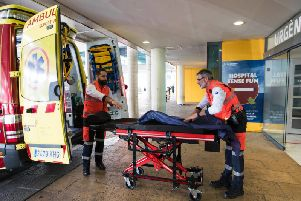Two men ready an ambulance outside the Son Espases University Hospital in Palma de Mallorca where a British man has been diagnosed with coronavirus, on February 9, 2020 (Photo: STRINGER/AFP via Getty Images)