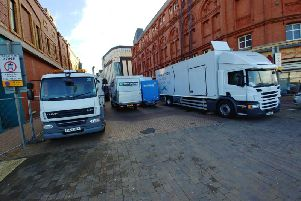 Production trucks are parked in Bank Hey Street, underneath the Tower