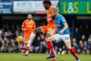 Blackpool's Armand Gnanduillet competing with Portsmouth's Jack Whatmough