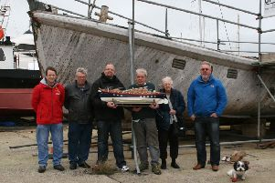 Members of the Ann Letitia Russell Rescue Group alongside the Ann Letitia Russell with a model of the Ann Letitia Russell