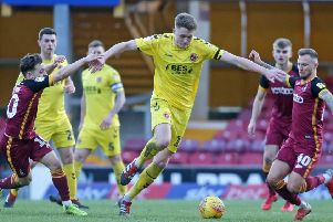 Fleetwood Town's Harry Souttar gets between Bradford City's Jack Payne (left) & Bradford City's David Ball