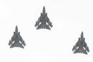 The three RAF Tornados fly over Warton