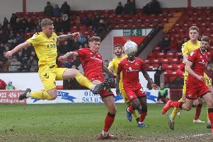 Ash Eastham has a strike on goal for Fleetwood Town at Walsall