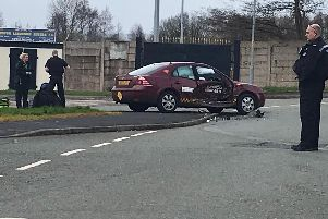 Police stop at the scene to help the taxi driver and his passenger. Credit: Supercabs