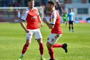 Ched Evans celebrates scoring against Southend with Wes Burns (left), who has extended his Fleetwood contract
