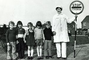 Children crossing the road, in the days when they used to walk to school