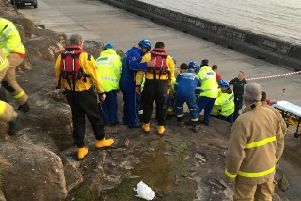 Rescuers formed a human chain to carry the man, 40, down the rocks after he plummeted onto them from the Promenade around 12 feet above