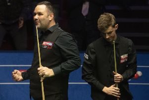 Stephen Maguire celebrates beating James Cahill
