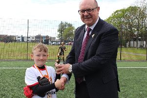 Ellis Mulhern, eight, is awarded player of the tournament by Duncan Armfield, the son of the late Blackpool and England captain Jimmy Armfield, following the Jimmy Armfield Memorial Tournament held at the Armfield Academy, Lytham Road, South Shore, on Wednesday