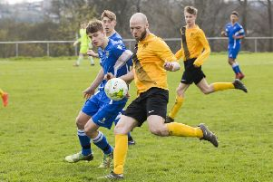 Brighouse Old Boys'  Graeme Tait  (in yellow) against  Huddersfield YM.