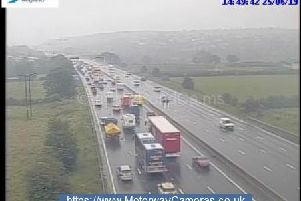 Motorists have been warned of up to 30 minutes of delays after flooding closed a lane of the M1. Picture: Highways England.