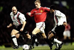 Steve Stone in pursuit of Manchester United's Nicky Butt at Old Trafford in 1998.