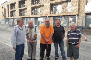 These residents are unhappy about the effects of the development behind them - from left: Stephen Barker,  Colin Bailey, Bob Handley, John Worthington and Alan Johnson
