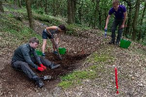 A group of volunteers are helping to unearthing the war-time secrets of a Calderdale wood.