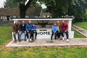 Brian Miller's family at the recreated dugout in the Turf Moor Memorial Garden