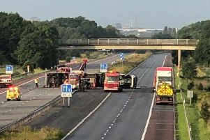 A lorry has crossed the central reservation and overturned after colliding with a number of vehicles on the M58 near Bickerstaffe at around 2am this morning (August 21). Credit: @Salford99