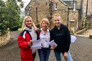 Smiling students collect their GCSE results at Fyling Hall