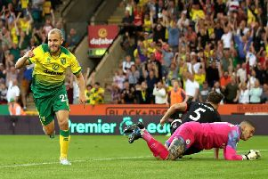 Norwich City striker Teemu Pukki scores against Manchester City at Carrow Road
