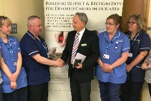 Nurse David Edwards receives his award at Gainsborough's John Coupland Hospital.