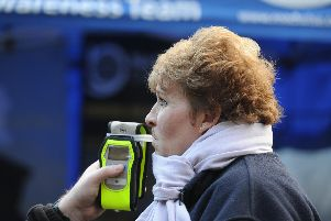 Woman is breathalysed.
