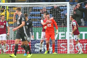 Ben Mee grabs Nick Pope to celebrate his penalty save