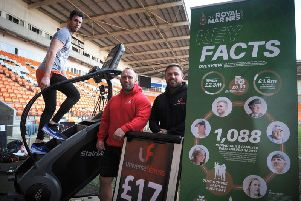 Matthew Disney taking on his challenge at Bloomfield Road in memory of Darren Daz Smith, as  Carl Etherington and Joseph Nicholson of Universe Gym who are supporting him watch on