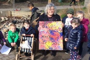 Jo Noble with the children at Gainsborough Nursery School with the placard they designed for her