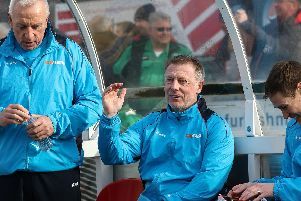 Ged McNamee (left) with manager Craig Hignett and coach Antony Sweeney (right).