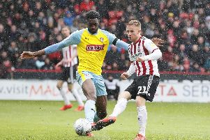 Semi Ajayi of Rotherham United  tackles Mark Duffy of Sheffield Utd during the Sky Bet Championship match at the Bramall Lane Stadium, Sheffield. Picture date: 9th March 2019. Picture credit should read: Simon Bellis/Sportimage