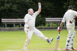 Cricket - Triangle v Birkby Rose Hill in the Rod Warhurst Cup semi-final. Roger Smith bowls for Triangle.